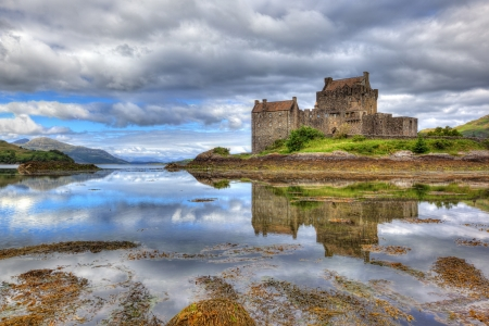 loch: Eilean Donan castle on a cloudy day, Highlands, Scotland, UK Editorial