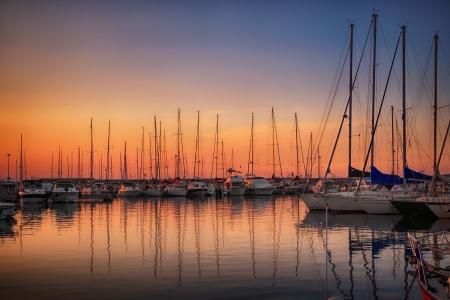 marina water: Marina with docked yachts at sunset in Giulianova, Italy Stock Photo