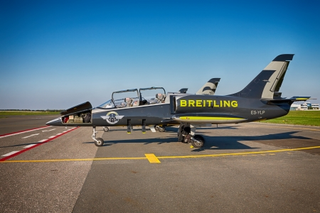 monoplane: PRAGUE - SEPTEMBER 6: Airplanes Aero L-39 Albatros from Breitling Jet Team on parking stand in Vaclav Havel Prague Airport on September 6, 2013. The Breitling Jet Team is the largest civilian aerobatic display team in Europe performing on jets. Editorial