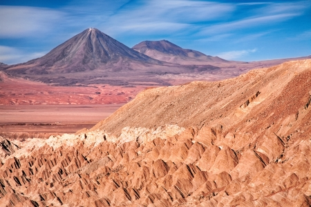 view from Valle de la Muerte (Death Valley) on the volcanoes Licancabur and Juriques, Chile photo