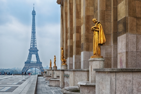 view from Trocadero with golden statues on Eiffel tower, Paris Stock Photo