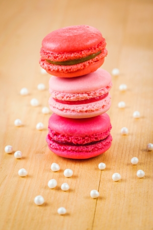 strawberry, raspberry and rhubarb macaroons on wooden table photo