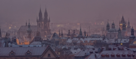Prague towers after sunset in winter, Czech Republic photo