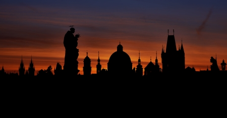 Prague silhouettes from Charles Bridge before dawn, Prague, Czech Republic photo