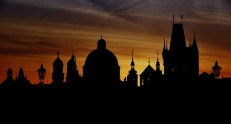 Prague silhouettes from Charles Bridge before dawn, Prague, Czech Republic photo