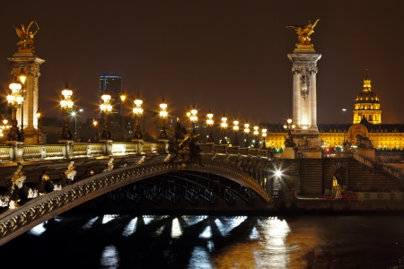 paris at night: The Alexander III Bridge across river Seine at night in Paris, France