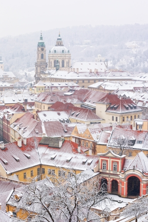 nicolas: winter roofs of Ledebursky palace and St  Nicolas church, Prague