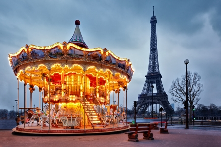 illuminated vintage carousel close to Eiffel Tower, Paris
