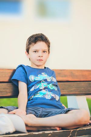 alone sad: sad boy sitting on a bench Stock Photo