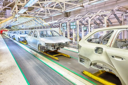 prepared chassis in a row at car plant