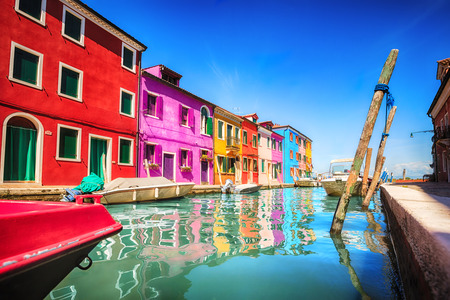 venice: Colourfully painted house facade on Burano island, province of Venice, Italy
