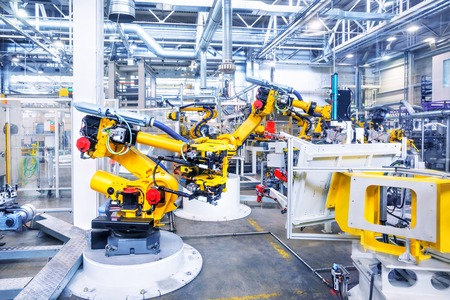automotive industry: robotic arms in a car plant