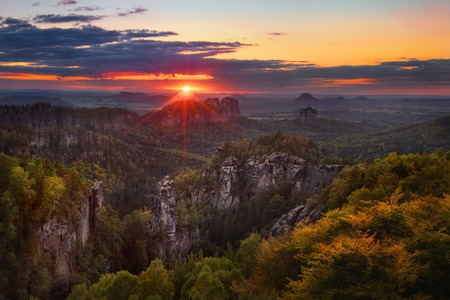 czech: colorful sunset view on Schrammsteine from Carolafelsen in the national park Saxon Switzerland, Germany Stock Photo