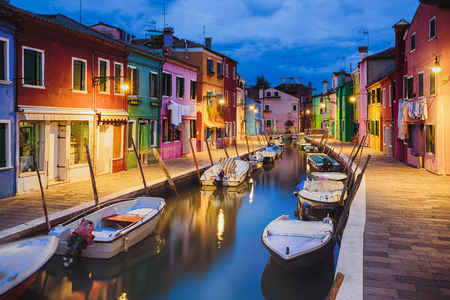 colourfully: Colourfully painted houses facade on Burano island in evening, province of Venice, Italy Stock Photo