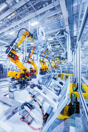 car manufacturing: robotic arms in a car plant