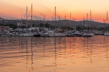 Marina with docked yachts at sunset in Giulianova, Italy Stok Fotoğraf