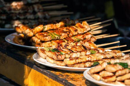 Cchicken sticks at at Nishiki market in Kyoto, Japan