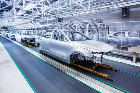 prepared chassis in a row at car plant Stock Photo