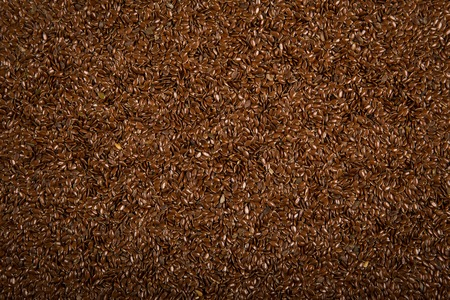 brown flax: Dry brown flax seeds, food background grains texture