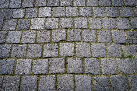 coatings: Stone paving dark quadrate texture in old town. Abstract structured background.
