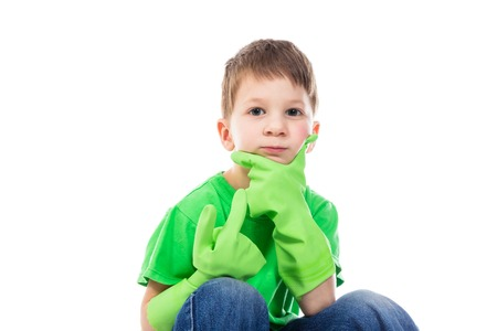 puzzlement: Ponderer small boy with Hand on the Face. Isolated on white background