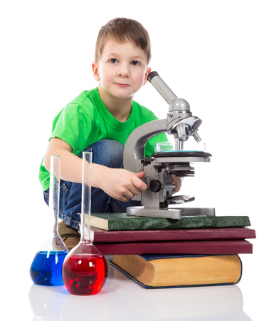 interested: Interested small boy with microscope. Isolated on white background