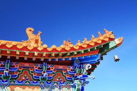 Beautiful asian temple on the blue sky background  photo