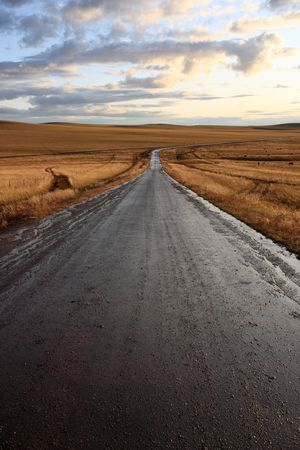 road in middle of rural area to evening  Stock Photo - 6129298