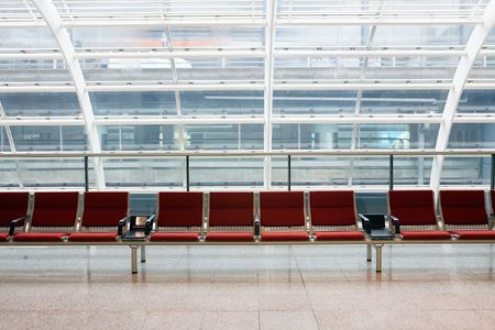 seating furniture: row of red chair at airport in Hongkong