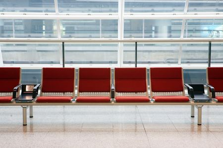 business lounge: row of red chair at airport in Hongkong