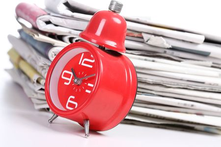 clock and newspaper Stock Photo - 6143527