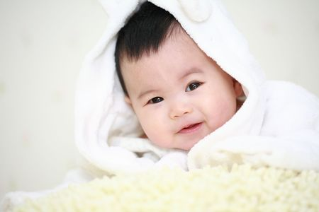 girl with towel: close up of cute asia baby