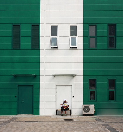 image of white single door against green wall