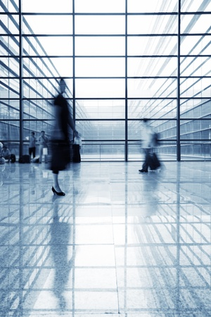 glass building: image of People silhouettes at morden office building  Editorial