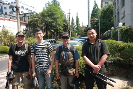 four person only: Men looking at the camera