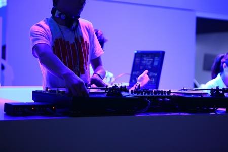 yong man playing CD