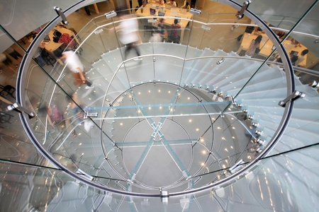 view of a staircase in a shop: modern glass spiral staircase in shop with motion step