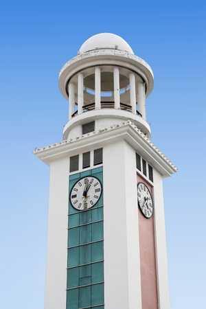 Clock tower in the blue sky background