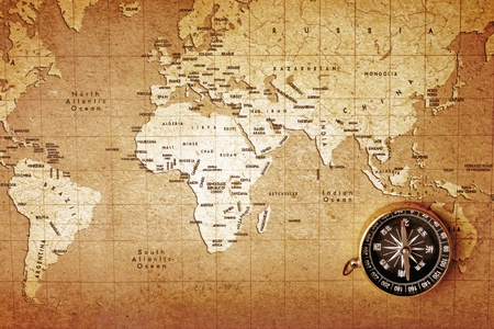vintage world map: An old brass compass on a Treasure map background