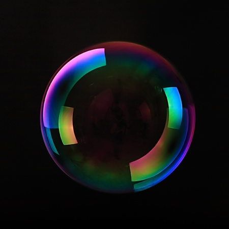Soap bubbles on black background   photo
