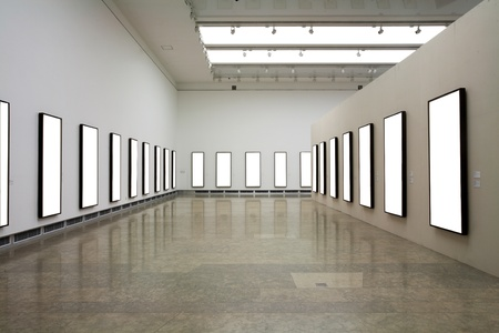 art gallery interior: empty frames in a room against a white wall   Stock Photo