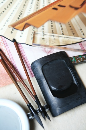 inkstone: Chinese writing brushes and inkstone on the table