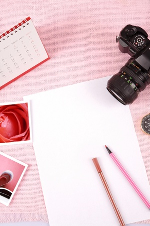 Clutter of objects stacked on pink background Stock Photo - 13450401