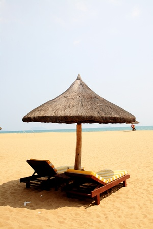 Sunshade and chairs on beach, Sanya, China  photo