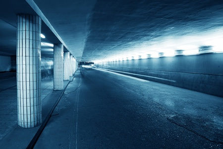 public space: Tunnel leading to the train platform   Stock Photo