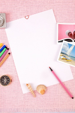 Clutter of objects stacked on pink background photo