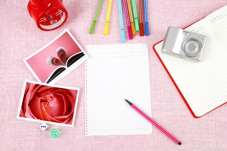 Clutter of objects stacked on pink background Stock Photo - 13496877
