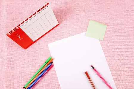 Clutter of objects stacked on pink background Stock Photo - 13496880