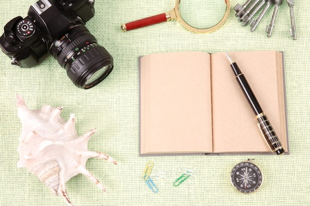 A pile of clutter items on green background photo