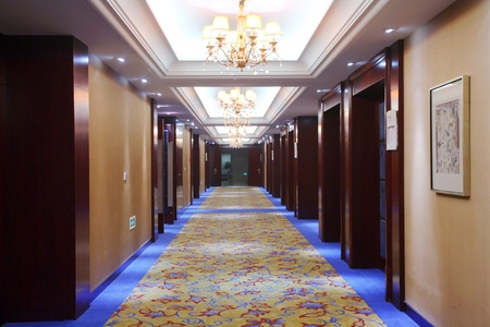 Empty hotel corridor with blue doors  Stock Photo - 13491752